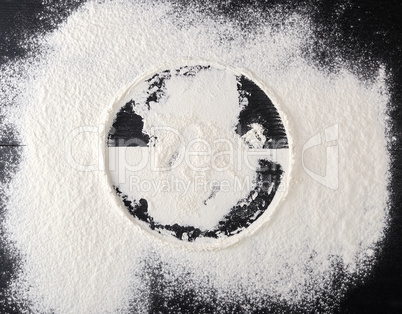 sprinkled white flour, round imprint from sieve
