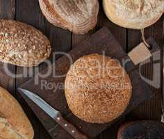 whole loaves of bread made of white wheat flour and rye with see