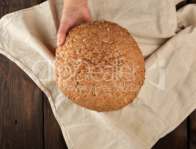 baked round rye bread with sunflower seeds