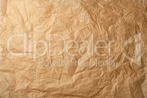 crumpled brown baking parchment paper