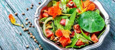 Salad with vegetables and nasturtium