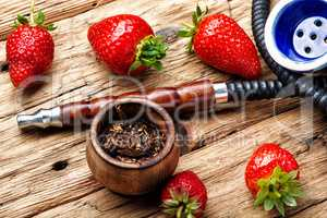 Smoking hookah on strawberry