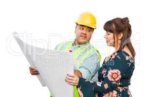 Hispanic Male Contractor Talking with Female Client Over Blueprint