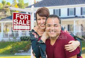 Mixed Race Young Adult Couple In Front of House and For Sign