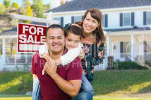 Happy Mixed Race Family In Front of House and For Sale Sign