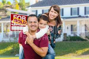 Happy Mixed Race Family In Front of House and Sold For Sale Sign