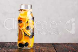Bottle of Water with Orange and Blackberry.