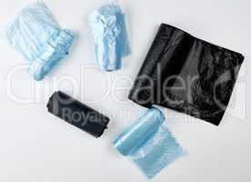 black and blue plastic bags for trash can on a white background