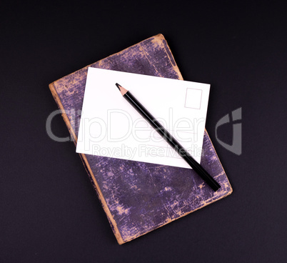 blank white paper card and black wooden pencil