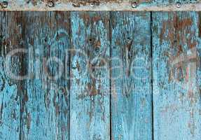 very old wooden background with blue cracked paint