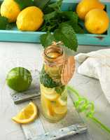 drink lemonade in a glass bottle and ripe fresh lemons