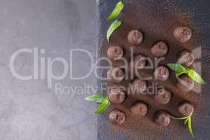 Top view of chocolate truffles powdered with cocoa