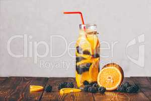 Bottle of Water with Orange and Blackberry