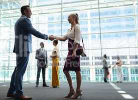 Caucasian diverse executives shaking hands in modern office