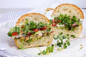 Sandwich with radish sprouts and vegetables
