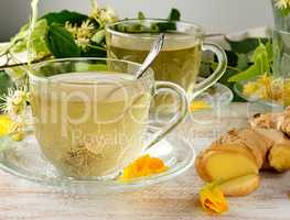 transparent cup with tea from ginger and linden