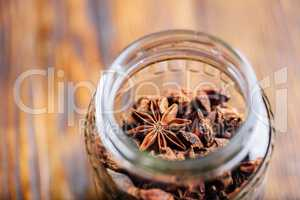 Jar of Star Anise Fruits and Seeds.