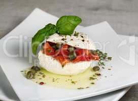 Mozzarella stuffed tomatoes with capers