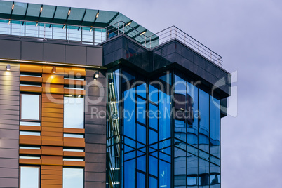 Modern high-rise building with a glass facade.