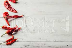 Red chili peppers on wooden background