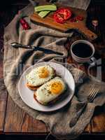 Breakfast toasts with vegetables and fried eggs with cup of coff