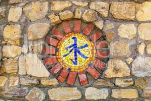 Mosaic religious symbol on wall.