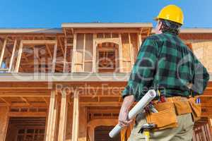 Contractor In Front New House Wood Framing at Construction Site