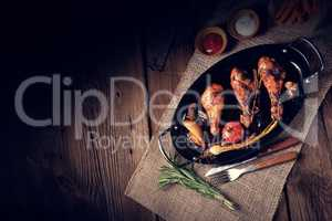 grilled chicken legs in barbecue marinade with sweet potatoes