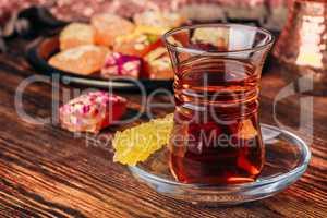 Tea in armudu glass with rahat lokum
