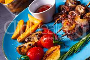 cattle shashlik skewers with grilled vegetables on a caucasian