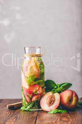 Detox Water with Peach and Basil.