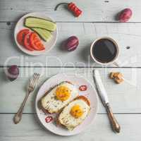 Breakfast toasts with vegetables and fried egg with cup of coffe