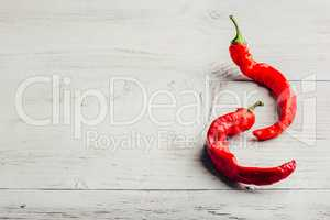 Two chili peppers on white background.