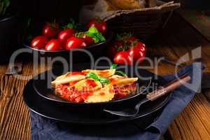 ravioli alla genovese with basil tomato sauce