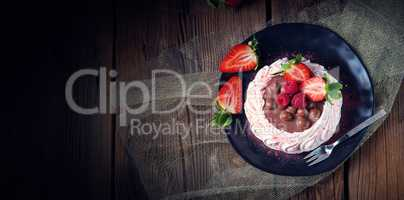 light pavlova with fresh fruits and chocolate