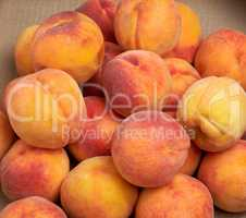 heap of ripe yellow-red round peaches