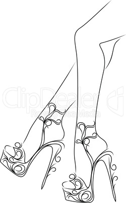Graceful female feet in shoes with high heels