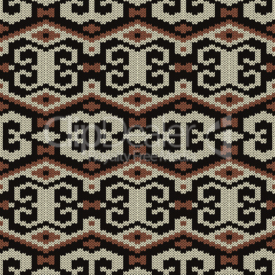 Geometrical ornate seamless knitted vector pattern as a fabric texture in brown and beige colors