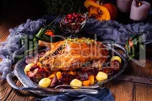 roast duck with potato dumplings and plums