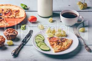 Breakfast frittata with with coffee, grapes and muffins.