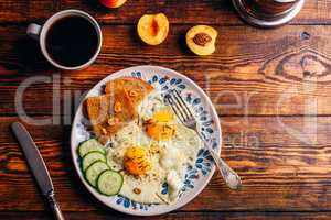 Breakfast toast with fried eggs with vegetables, coffee and frui