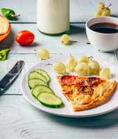 Healthy breakfast with frittata and cup of coffeeon wooden backg