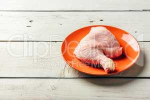 Chicken leg on orange plate