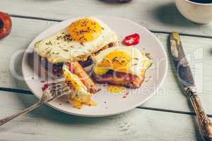 Bruschettas with vegetables and fried egg, cup of coffee and som