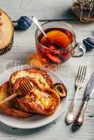 French toasts with honey, fruits and tea