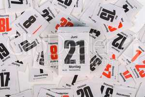 June 21 - the beginning of summer. Calendar sheets scattered across the table