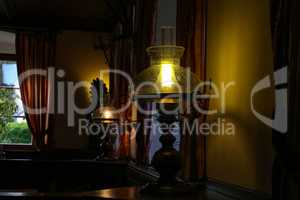 A beautiful table lamp stands in a room