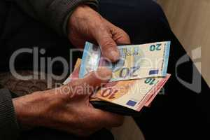 Pension / Money in the hands of an old man