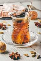 Tea in glass with turkish delight, different spices and navat sugar