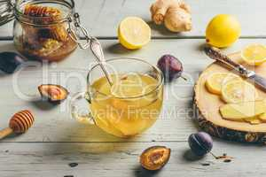 Cup of tea with lemon, honey and ginger